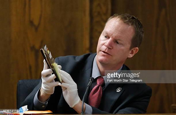 Texas Ranger Danny Briley identifies the suspect's wallet during the capital murder trial of former Marine Cpl. Eddie Ray Routh at the Erath County,...