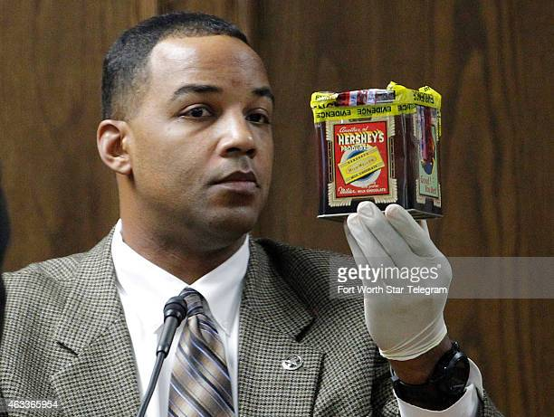 Texas Ranger David Armstrong holds up evidence seized at Eddie Ray Routh's house during the capital murder trial of former Marine Cpl Eddie Ray Routh...