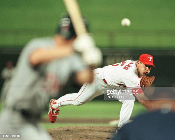 Texas Ranger pitcher John Wetteland delivers a pitch in the top of the ninth inning against the Detroit Tigers at The Ballpark in Arlington in...