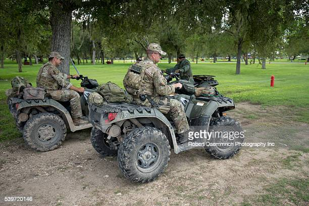Texas Ranger reconnaissance team heads out into the brush along the Rio Grande River in Granjeno, Texas where human smuggling and drug activity...