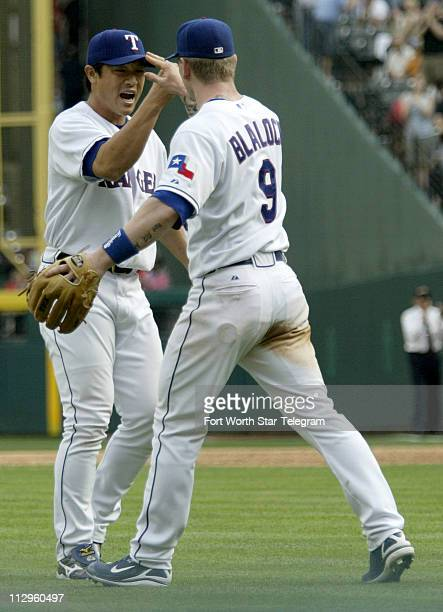 Texas Rangers Akinori Otsuka and Hank Blaylock celebrate after the Rangers victory over the Oakland Athletics 43 at Rangers Ballpark in Arlington...