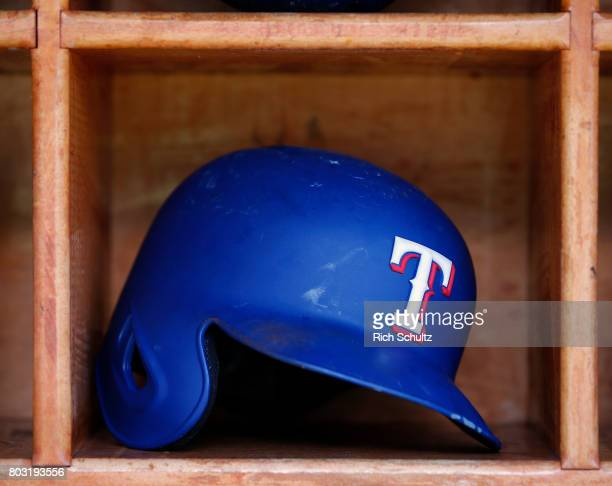 Texas Rangers batting helmet in the dugout before a game against the New York Yankees at Yankee Stadium on June 24 2017 in the Bronx borough of New...