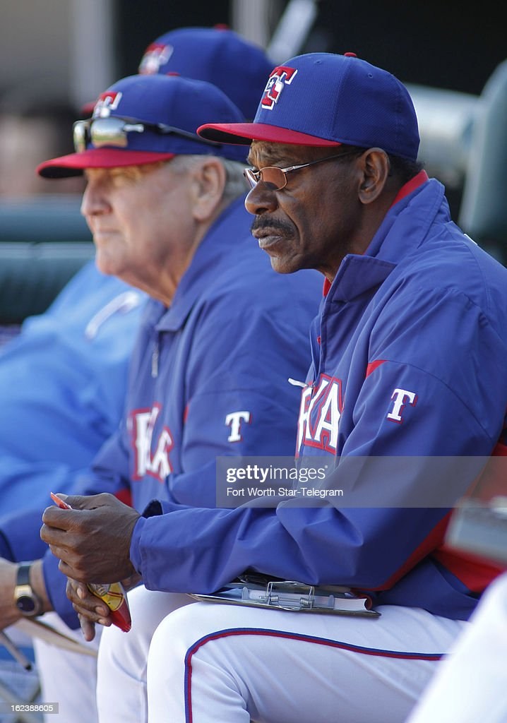 Texas Rangers bench coach Jackie Moore, left, and manager Ron Washington watch a spring training game against the Kansas City Royals in Surprise, Arizona, Friday, February 22, 2013. The game finished in a 5-5 tie.