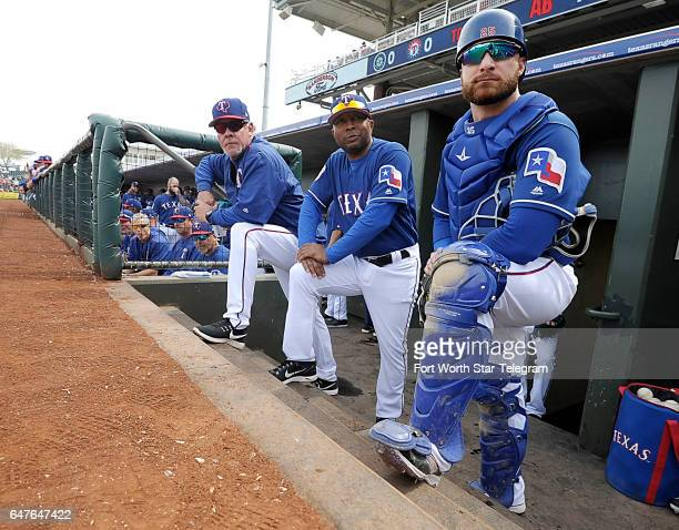 Texas Rangers bench coach Steve Buechele third base coach Tony Beasley and catcher Jonathan Lucroy ready to go as the Texas Rangers play the Seattle...