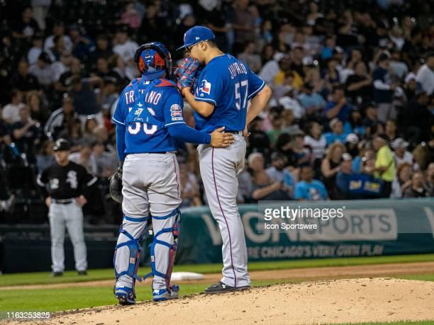 Texas Rangers catcher Jose Trevino communicates with Texas Rangers relief pitcher Ariel Jurado during the MLB regular season game between the Texas...
