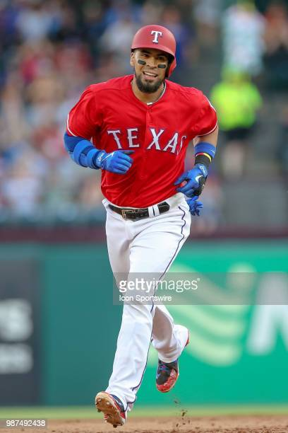 Texas Rangers Catcher Robinson Chirinos circles the bases after hitting a home run during the game between the Chicago White Sox and Texas Rangers on...