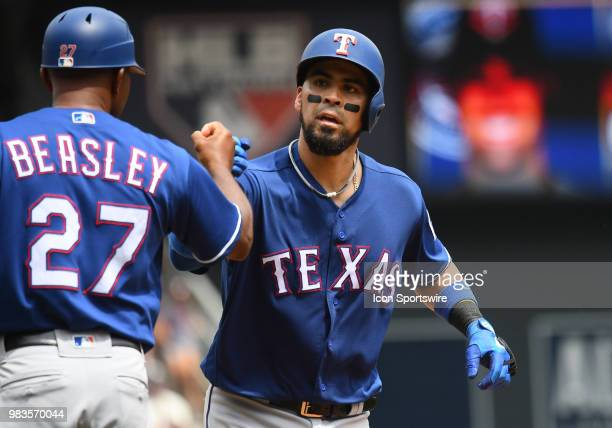 Texas Rangers Catcher Robinson Chirinos fistbumps Texas Rangers third base coach Tony Beasley after hitting a 2run home run in the top of the 3rd...