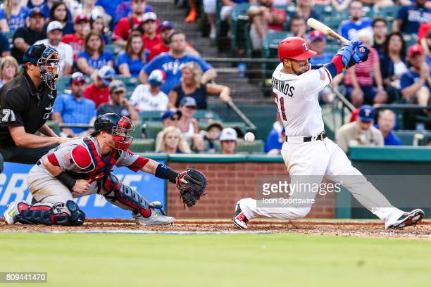 Texas Rangers catcher Robinson Chirinos hits a foul ball in front of Boston Red Sox catcher Christian Vazquez during the game between the Texas...