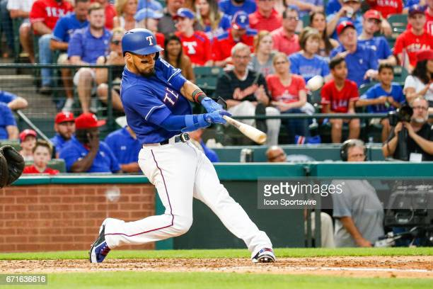 Texas Rangers Catcher Robinson Chirinos hits a home run during the MLB game between the Kansas City Royals and Texas Rangers on April 21 2017 at...