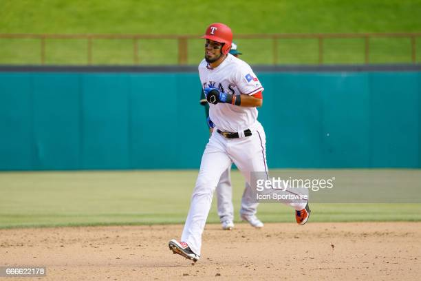 Texas Rangers Catcher Robinson Chirinos rounds the bases after hitting a home run during the MLB baseball game between the Oakland Athletics and...