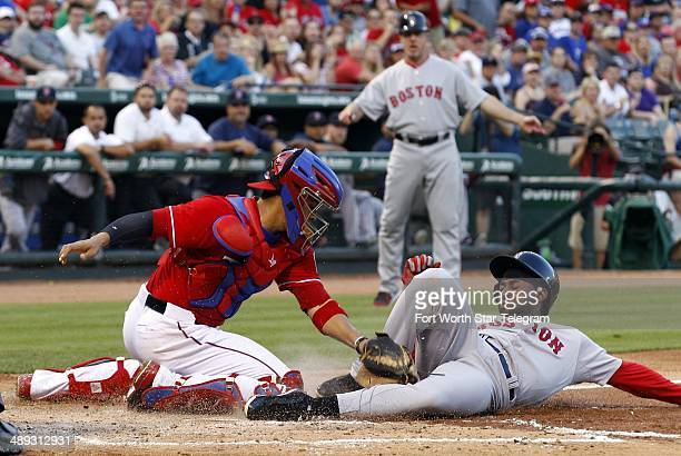 Texas Rangers catcher Robinson Chirinos tags out Boston Red Sox Jackie Bradley Jr. At home plate in the second inning at Globe Life Park in...