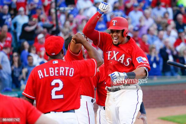Texas Rangers Center field Carlos Gomez celebrates after hitting a home run during the MLB opening day baseball game between the Texas Rangers and...