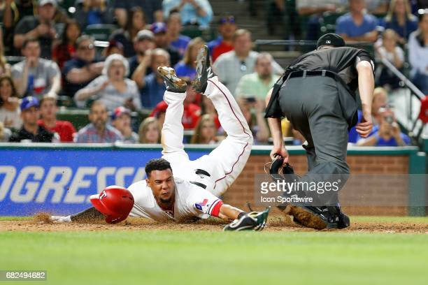 Texas Rangers Center field Carlos Gomez slides home safe to tie the MLB game between the Oakland Athletics and Texas Rangers on May 12 2017 at Globe...