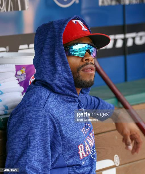 Texas Rangers Center field Delino DeShields watches the baseball game between the Houston Astros and Texas Rangers from the bench as he recovers from...