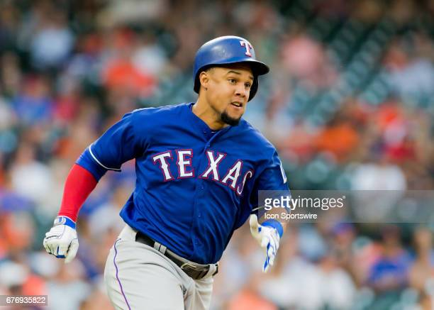 Texas Rangers center fielder Carlos Gomez taps first base and races to second base during a game between the Texas Rangers and Houston Astros on May...