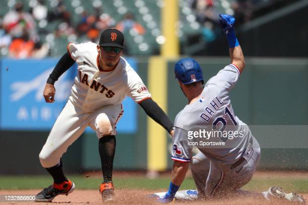 Texas Rangers center fielder David Dahl steals second base sliding ahead of the tag from San Francisco Giants second baseman Wilmer Flores during the...
