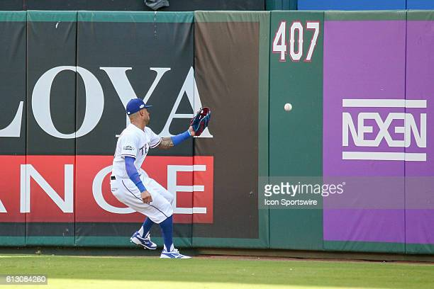 Texas Rangers center fielder Ian Desmond plays a ball off the center field wall during game 1 of the ALDS between the Toronto Blue Jays and Texas...