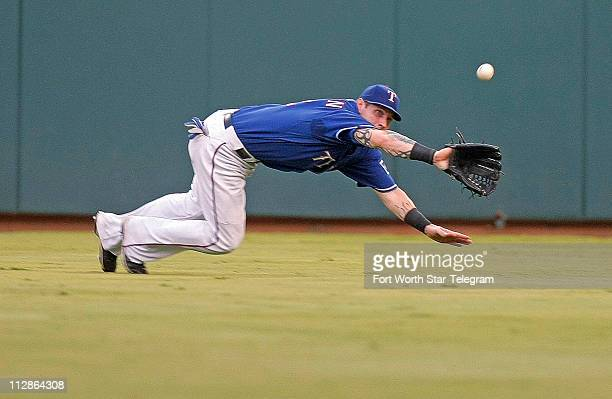 Texas Rangers center fielder Josh Hamilton catches a fly ball from Seattle Mariners catcher Kenji Johjima in the fourth inning at Rangers Ballpark in...