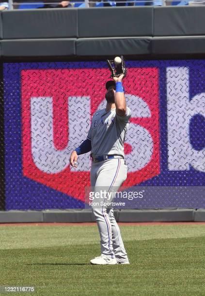 Texas Rangers centerfielder David Dahl catches a fly ball for an out during an American League baseball game between the Texas Rangers and the Kansas...