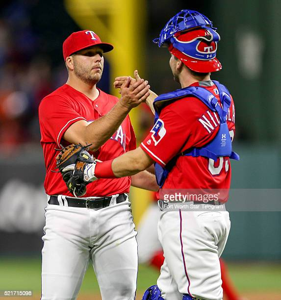 Texas Rangers closer Shawn Tolleson left is congratulated by catcher Brett Nicholas after the final out in an 84 win against the Baltimore Orioles on...