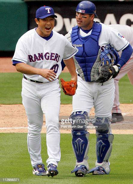 Texas Rangers' closing pitcher Akinori Otsuka and catcher Gerald Laird celebrate their 20 win over the Texas Rangers in Arlington Texas on Friday...