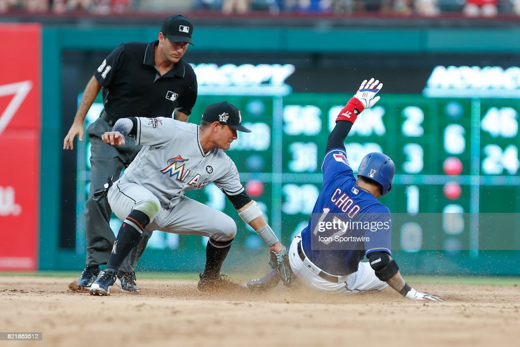 Texas Rangers Designated hitter Shin-Soo Choo (17) is called out on a tag by Miami Marlins Infield Miguel Rojas (19) during the MLB game between the Miami Marlins and Texas Rangers on July 24, 2017 at Globe Life Park in Arlington, TX.