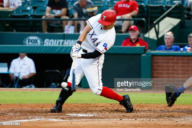 Texas Rangers designated hitter ShinSoo Choo makes contact with a pitch during the MLB game between the New York Mets and Texas Rangers in June 72017...