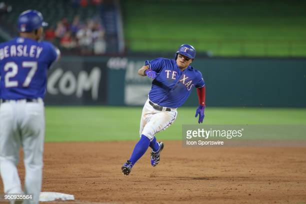 Texas Rangers designated hitter ShinSoo Choo rounds third to score during the game between the Texas Rangers and the Oakland Athletics on April 24...