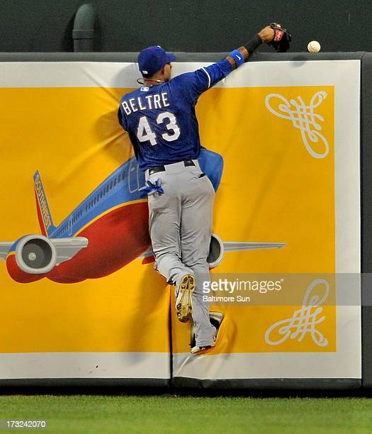 Texas Rangers' Engel Beltre loses a long fly by Baltimore Orioles' Brian Roberts in the 4th inning at Oriole Park at Camden Yards in Baltimore...