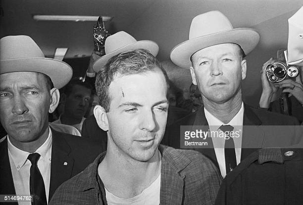 Texas Rangers escort accused Kennedy assassin Lee Harvey Oswald into a Dallas police facility