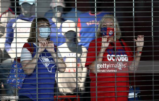 Texas Rangers fans look at the concourse of Globe Life Field from the team store before a game against the Colorado Rockies on July 25, 2020 in...