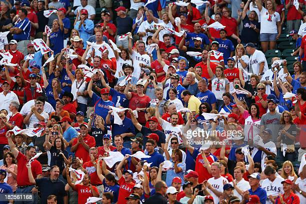 Texas Rangers fans prepare for their game against the Tampa Bay Rays during the American League Wild Card tiebreaker at Rangers Ballpark in Arlington...
