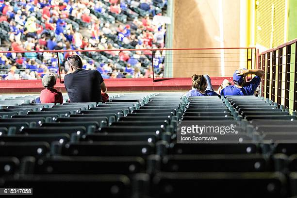 Texas Rangers fans watch the game from the corner third deck seats during the game between the Texas Rangers and the Los Angeles Angels at Globe Life...