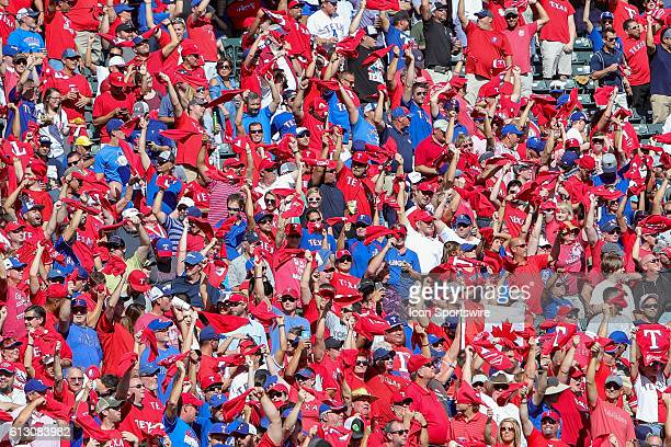 Texas Rangers fans wave red towels during game 1 of the ALDS between the Toronto Blue Jays and Texas Rangers at Globe Life Park in Arlington TX