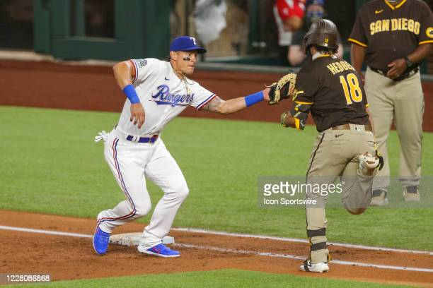 Texas Rangers first baseman Derek Dietrich tags San Diego Padres catcher Austin Hedges out at during the MLB game between the San Diego Padres and...