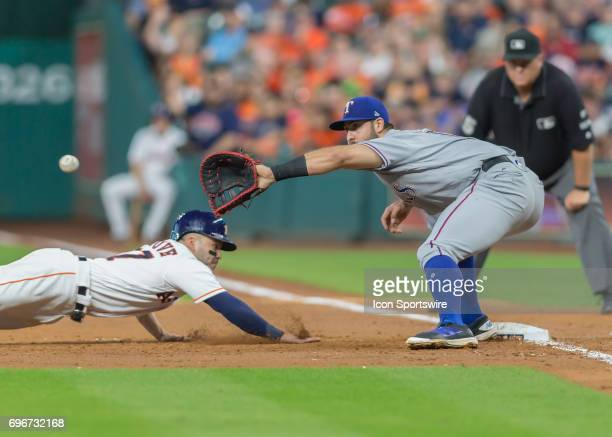 Texas Rangers first baseman Joey Gallo reaches out to catch a ball before Houston Astros second baseman Jose Altuve can beat the tag during the MLB...
