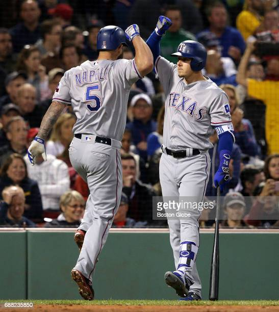 Texas Rangers first baseman Mike Napoli celebrates with Texas Rangers left fielder Ryan Rua after his solo home run during the fifth inning. The...