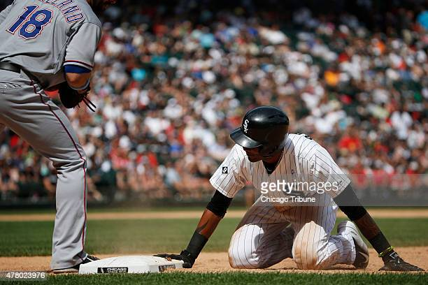 Texas Rangers first baseman Mitch Moreland attempts to pick off Chicago White Sox shortstop Alexei Ramirez on Sunday June 21 at US Cellular Field in...