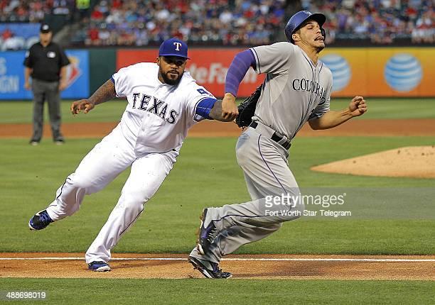 Texas Rangers first baseman Prince Fielder left tags out Colorado Rockies base runner Nolan Arenado to end the third inning in Arlington Texas on...