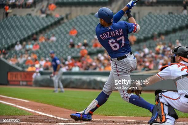 Texas Rangers first baseman Ronald Guzman hits a grand slam home run in the first inning during the game between the Texas Rangers and the Baltimore...
