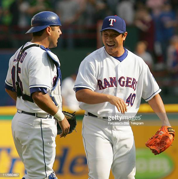 Texas Rangers' Gerald Laird left and Akinori Otsuka right celebrate after Otsuka closed out the Rangers 43 victory over the Oakland Athletics at the...