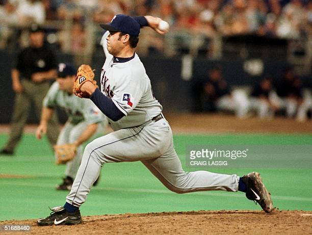 Texas Rangers' Hideki Irabu throws a pitch in the ninth inning Irabu to help the Rangers beat the Minnesota Twins 65 at the Metrodome 22 May 2002 in...