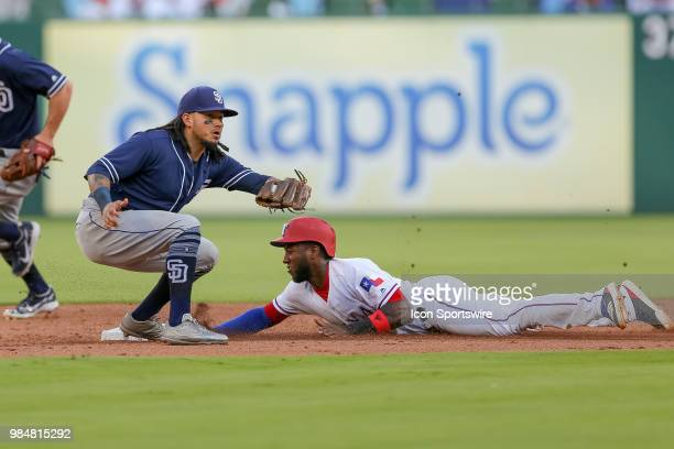 Texas Rangers Infield Jurickson Profar slides in under the tag of San Diego Padres Shortstop Freddy Galvis during the game between the San Diego...