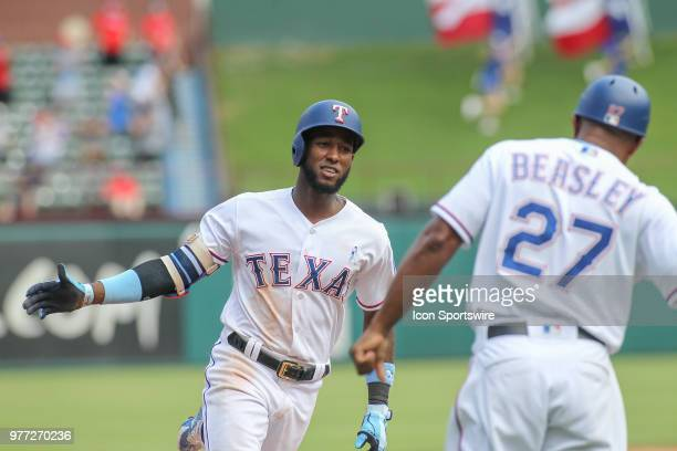 Texas Rangers infielder Jurickson Profar is congratulated by third base coach Tony Beasley while rounding third after hitting a home run during the...