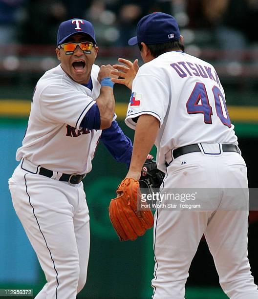 Texas Rangers' Jerry Hairston Jr celebrates with closing pitcher Akinori Otsuka after the Texas Rangers defeated the Boston Red Sox 20 in Arlington...