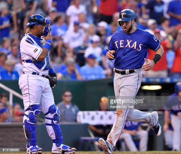 Texas Rangers' Joey Gallo scores in front of Kansas City Royals catcher Salvador Perez on a single by ShinSoo Choo in the ninth inning July 15 2017...