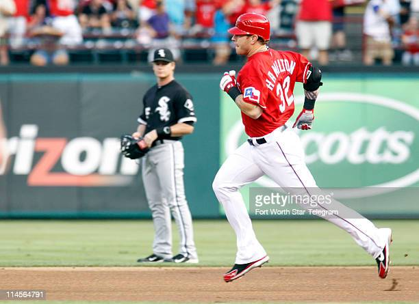 Texas Rangers Josh Hamilton rounds the bases after hitting a home run in the first inning against the Chicago White Sox at Rangers Ballpark in...
