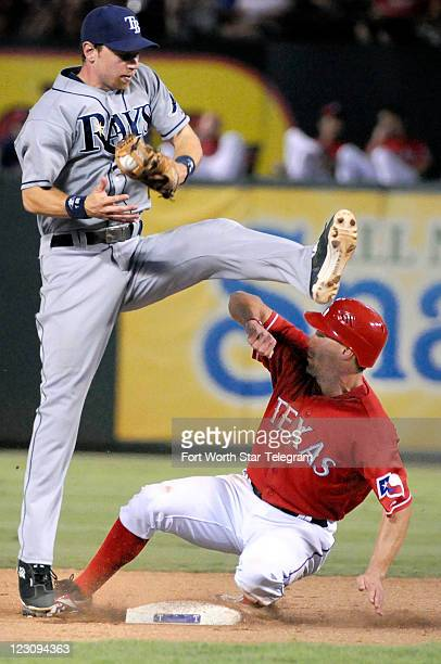 Texas Rangers left fielder David Murphy was safe at second base, as Tampa Bay Rays second baseman Ben Zobrist can't come down with the ball in the...