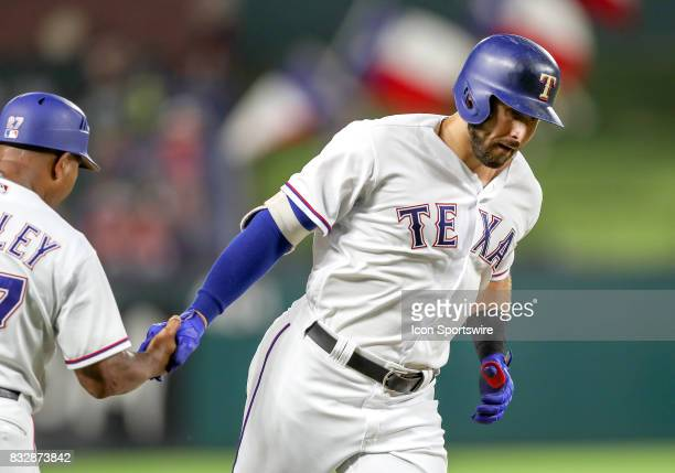 Texas Rangers left fielder Joey Gallo gets congratulated by third base coach Tony Beasley after hitting a home run during the MLB game between the...