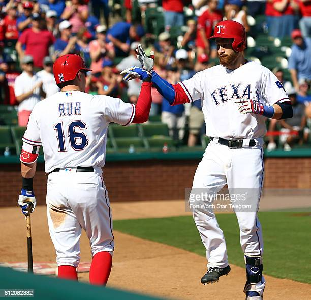 Texas Rangers left fielder Ryan Rua celebrates a fourth inning solo home run by Jonathan Lucroy against the Tampa Bay Rays on Sunday, Oct. 2 at Globe...